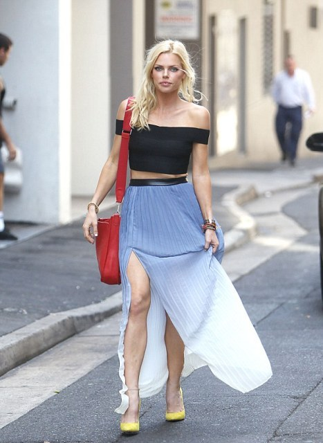 With black off the shoulder top, red bag and yellow pumps