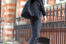 With black sweater, tote bag and dark gray jeans