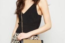 With black top and leopard skirt