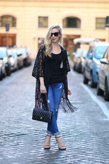 With black top, black chain strap bag, cuffed jeans and ankle strap high heels
