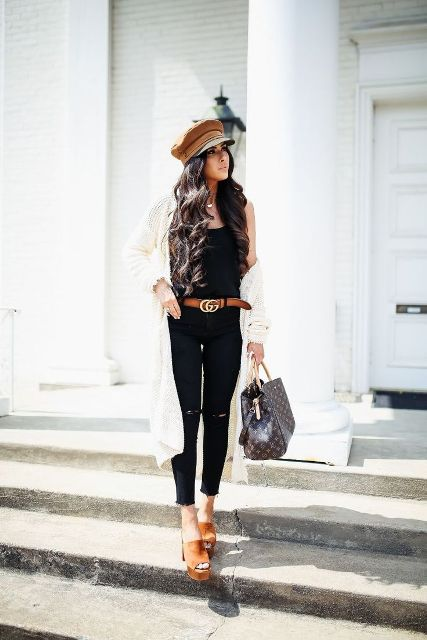 With black top, brown cap, printed bag, platform sandals, black skinny pants and white long cardigan