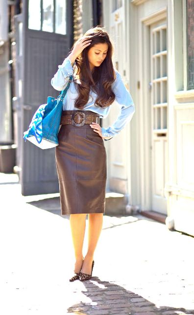 With blue shirt, brown leather pencil skirt, leopard pumps and blue bag