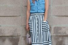 With blue sleeveless shirt, leopard scarf, beige bag and pink pumps