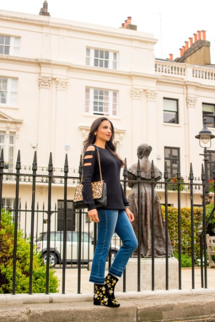 With cutout sweater, leopard chain strap bag and cropped jeans