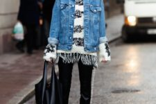 With denim jacket, black tote bag, black trousers and ankle boots
