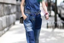 With denim sleeveless shirt, printed bag and beige lace up boots
