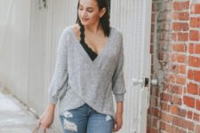 With distressed jeans, ankle boots and printed tote bag