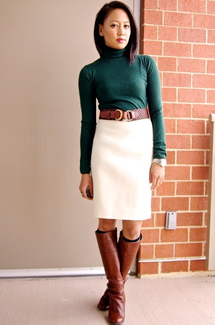 With emerald turtleneck, white skirt and brown leather high boots