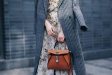 With floral dress, brown bag and black shoes