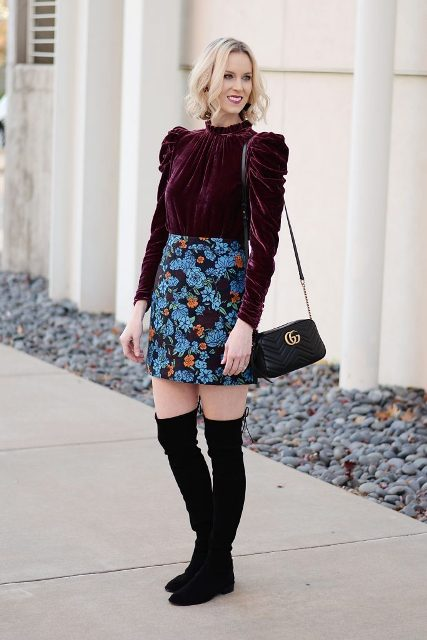 With floral mini skirt, black small bag and black over the knee boots