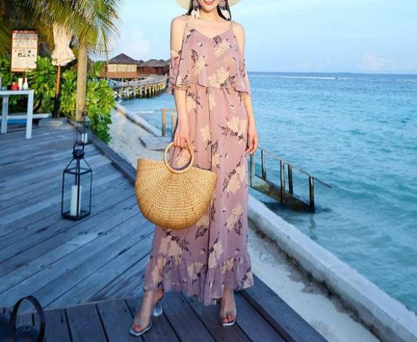 With floral ruffled maxi dress and high heels