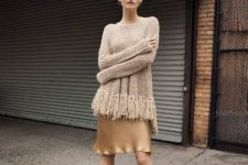 With golden satin skirt and beige pumps