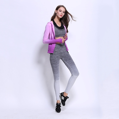 With gray crop top, ombre jacket and sneakers