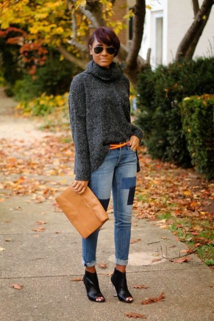 With gray loose sweater, brown belt, brown clutch and cutout ankle boots