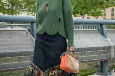 With green sweater, fringe skirt and three colored bag