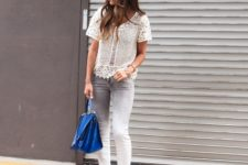 With knitted shirt, cobalt blue bag and black ankle strap shoes