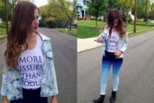 With labeled t-shirt, black boots and denim jacket