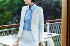 With light blue blouse