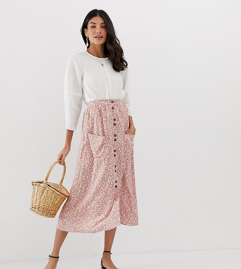 With loose blouse, straw bag and black shoes