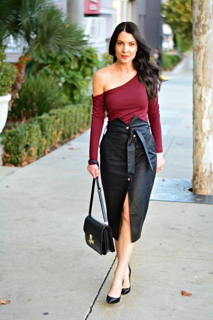 With marsala one shoulder shirt, black pumps and black bag