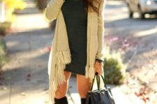 With mini dress, black bag and black high boots
