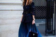 With navy blue blazer, black belt, bag and pumps