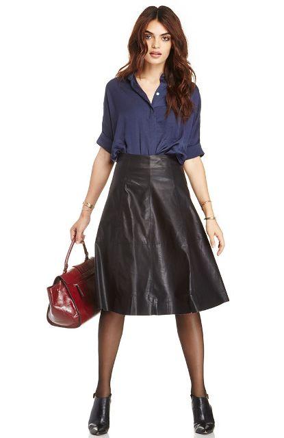 With navy blue shirt, marsala bag and black high heels