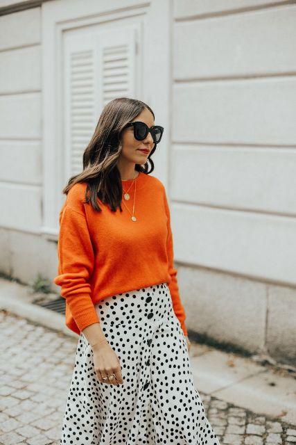 With orange loose sweatshirt and sunglasses