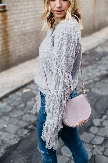 With pale pink bag and jeans