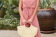 With pale pink jumpsuit and sandals