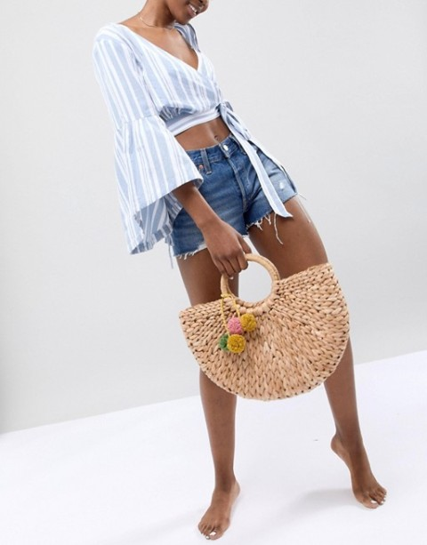 With pastel colored striped crop blouse and denim shorts