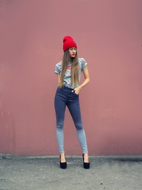 With polka dot t shirt, red hat and black high heels