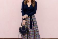 With printed midi skirt, black bag and black shoes