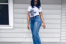 With printed t-shirt and loose jeans