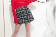 With red long sleeved turtleneck, beret and platform lace up boots