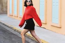 a fall look with a mini skirt and a red sweater