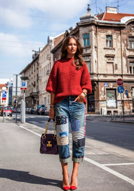 With red loose sweater, red pumps and purple chain strap bag