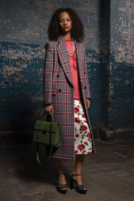 With shirt, floral skirt, green bag and zebra printed shoes