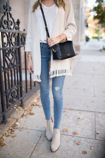 With skinny jeans, white shirt, black crossbody bag and beige boots