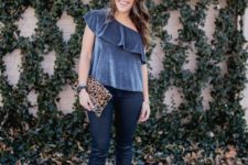 With skinny pants, black pumps and leopard clutch