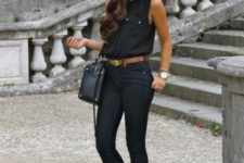 With sleeveless shirt, skinny pants, leopard flats and black bag