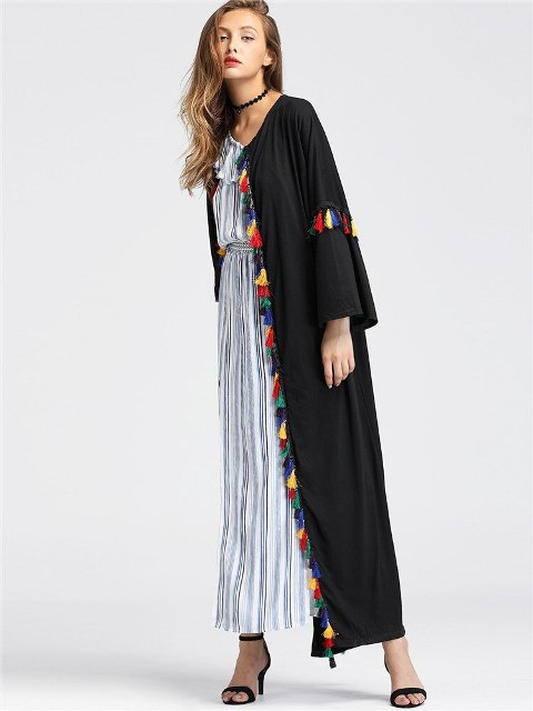 With striped maxi dress and high heels