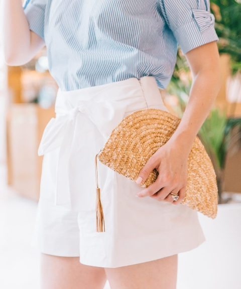 With striped shirt and white belted shorts