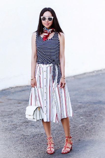 With striped top, white bag and embellished sandals