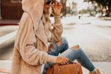 With super distressed jeans and brown leather bag
