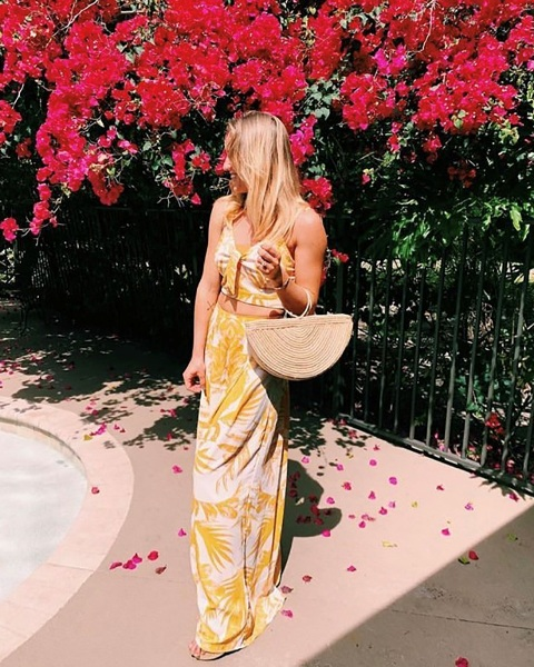 With tropical printed top and maxi skirt