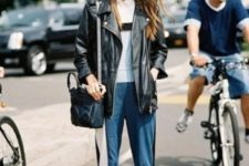 With white and black t-shirt, black oversized jacket, bag and flat sandals