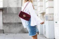 With white blouse, velvet bag and denim skirt
