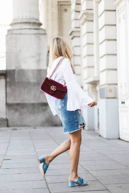 With white blouse, velvet bag and denim skirt