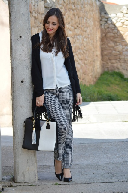With white button down shirt, checked trousers, black pumps and three colored bag
